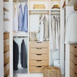 Small Closet With Area For Hanging Clothes Drawers And Rattan Woven Chair