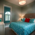 turquoise bedding with coral orange pillow