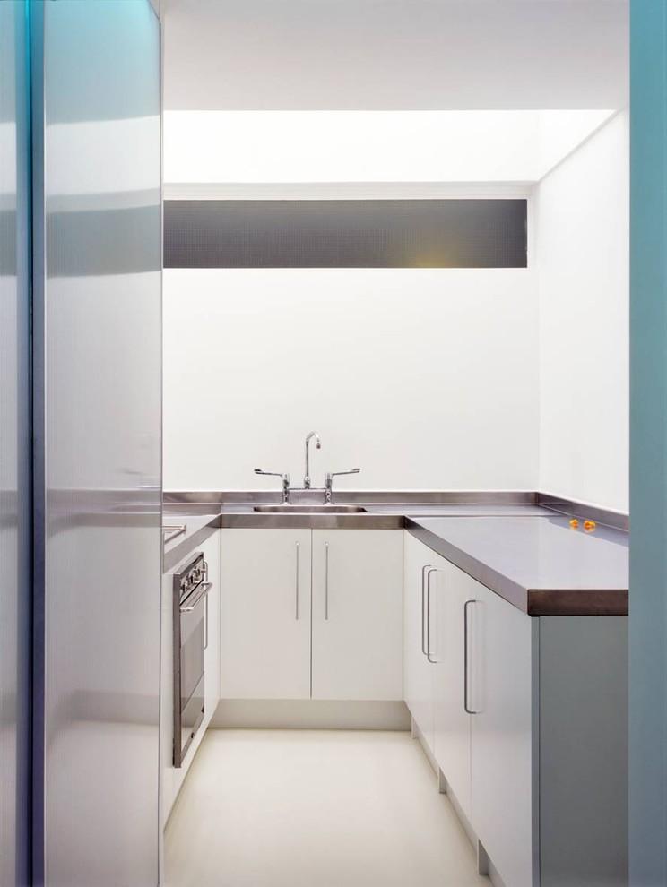 u shaped kitchen metal faucet metal elements cabinets ceiling floor sink door countertop