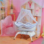 white and blue really small baby cot