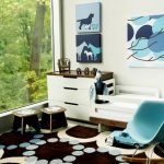 white blue brown wheme room with blue chair, white beds, brown rug, blue paintings, two wooden chair, white cabinet