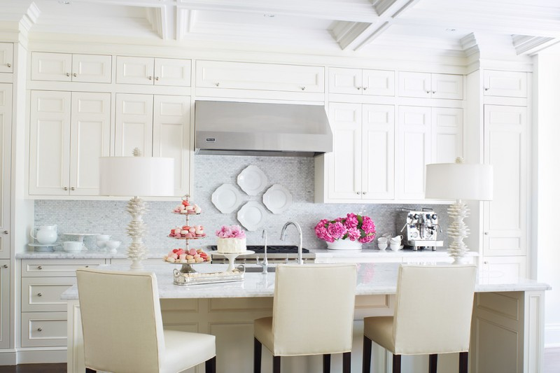 white kitchen upholstered dining chairs wall cabinet pink flowers plates cups white ceiling stove metal faucet
