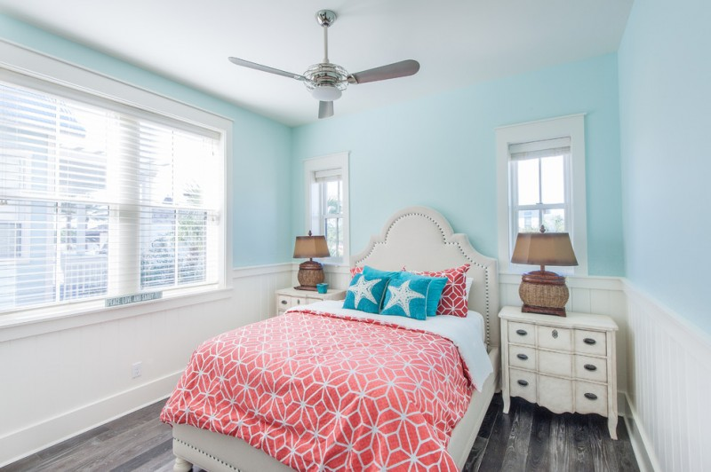 white linen coral comforter and turquoise pillows