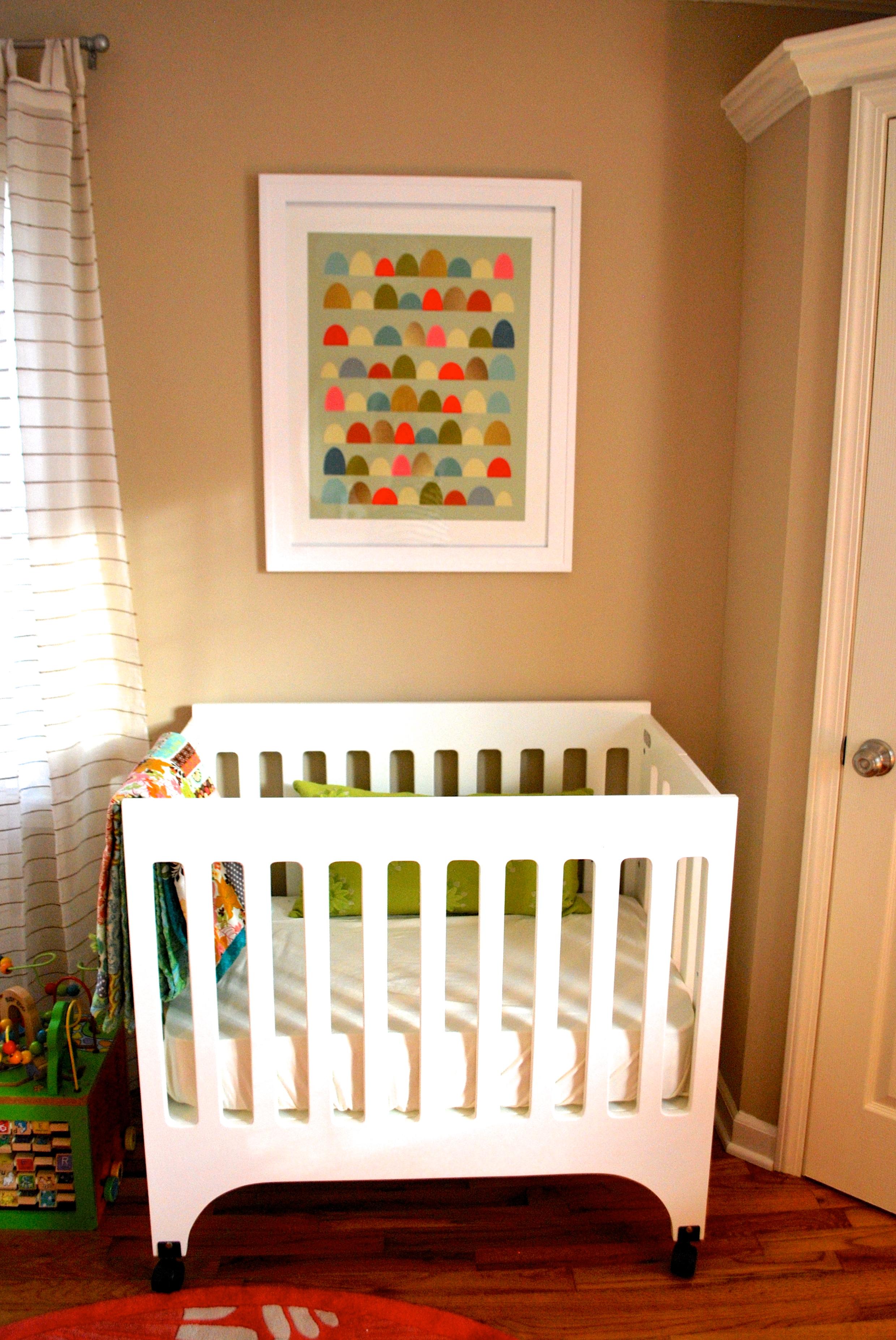 white simple small baby crib