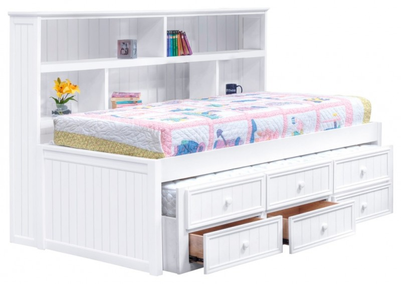 white wooden bed with shelves and drawers