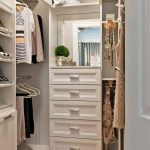 White Wooden Small Closet With Drawers And Mirrors