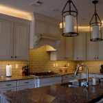 white wooden traditional kitchen with LED lcabinte lighting above and under the cabinet