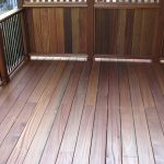 Wooden Closed Railing And Metal Vertical Railing
