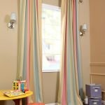 Ambrosia Stripe Curtains Supported By Textured Chrome Rods Soft Beige Walls A Pair Of Wall Lamps Small Table And Chair For Kids Grey Rug Idea