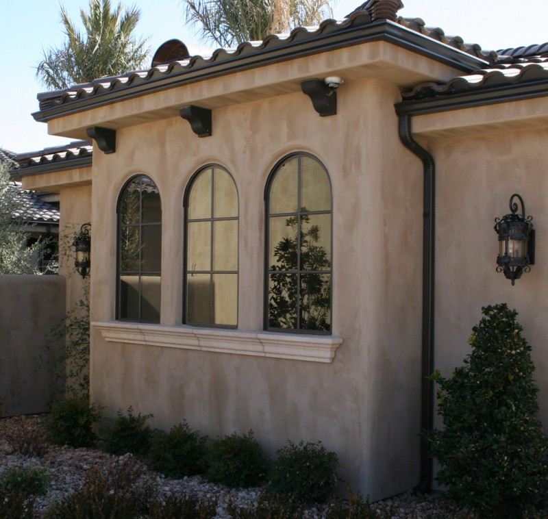 Mediterranean exterior idea with Mediterranean styled exterior windows