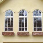 Mediterranean Style Exterior With Curved Exterior Windows Plus Decorative Copper Planters Underneath