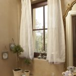 Mediterranean Style Powder Room For Girls With Light Vanity With Gold Framed Mirror Glass Window Equipped With Half White Sheers Gold Toned Window Rod Light