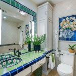 Mexican Style Bathroom With Bright Colored Tiles Walls Little Blue Tiles As Decorative Finish Floral Motif Vessel Sink Large Mirror White Toilet And White Ceramic Tiles For Bathroom Walls
