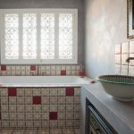 Moroccan Bathroom Idea With Accent Vessel Sink And Traditional Motif Tiles For Backsplash Area And Floors
