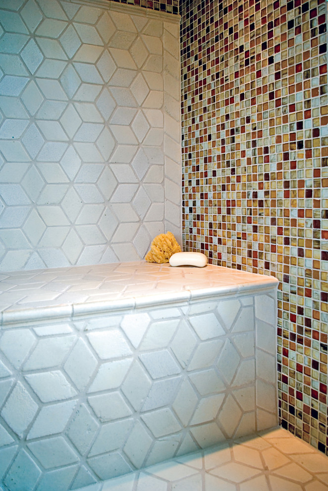Moroccan style bathroom design with mosaic glass walls and white diamond shaped floors and shower bench