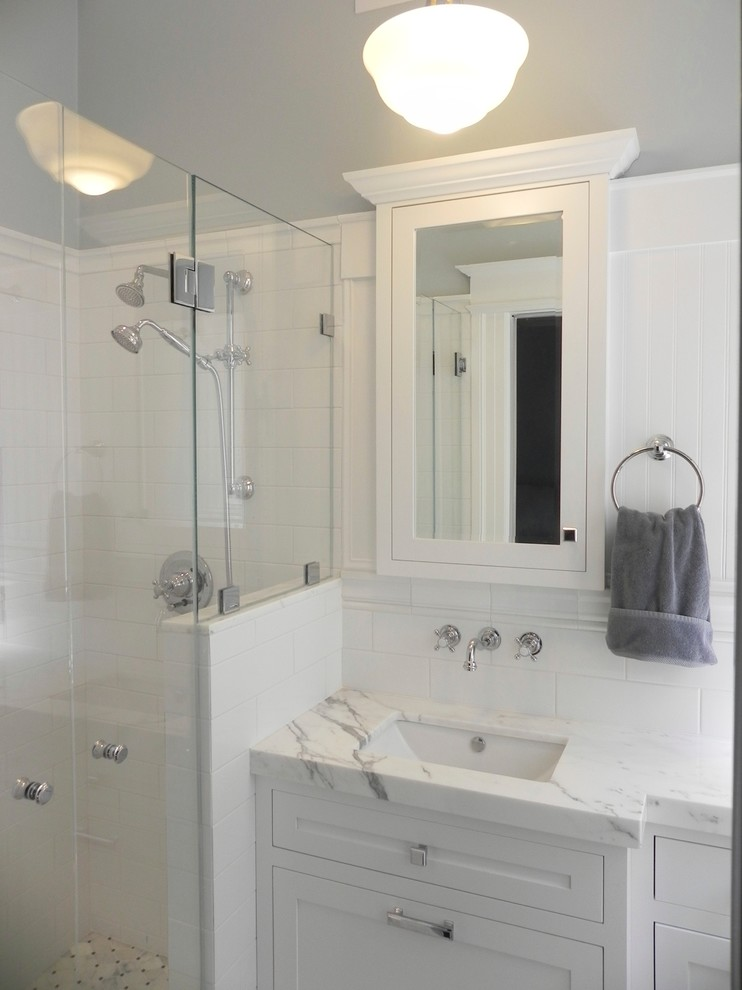 all white small master bathroom with cabinet, sink, mirror,