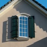 Arch Top Exterior Window With White Color Aluminum Trims And Deep Green Panel Additions