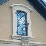 Artistic Exterior Window Idea With Custom Black Wrought Iron Bars Addition