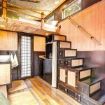 asian staircase with cabinet with wooden door and wicker door, shelves
