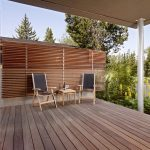 Back Porch In Minimalist Style A Couple Of Outdoor Chairs With Small Wooden Table Wooden Slabs Flooring System Wooden Slabs Walls For Porch Mini Back Garden