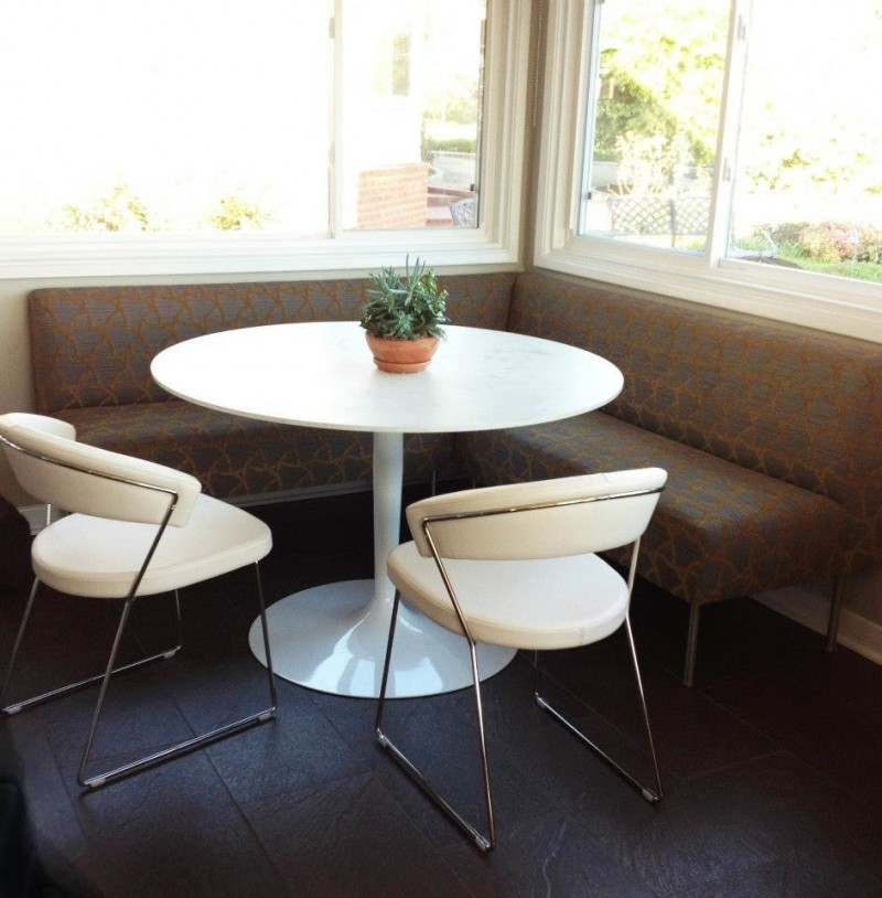 banquette set with brown corner sofa, white round table, white modern chairs