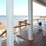 Beach House's Deck With Simple Horizontal Stainless Steel Wire Railings And Wooden Accents On Top White Wooden Furniture
