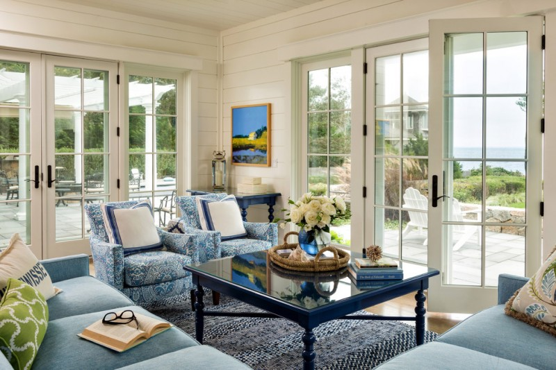 beach white horizontal wood paneling in sunroom