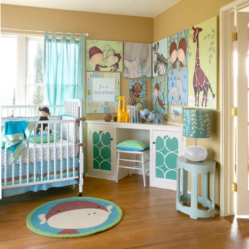 bedroom for kids with animal paintings, stuffed animal, wooden flooring, white crib with blue white bed, white table and chair with blue accent