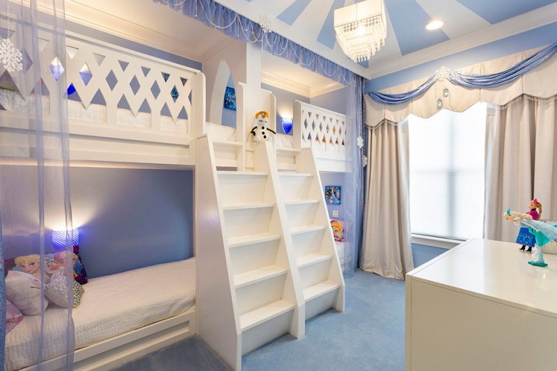 bedroom with light indigo wall, white bunk bed, white curtain with blue accent, white cabinet