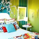 best colour combination green walls red light blue yellow bed small table lamp wall decor eclectic room