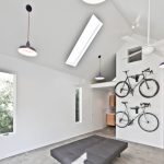 bike rack for apartment hanging lights contemporary bedroom books bookshelves windows lamps wood