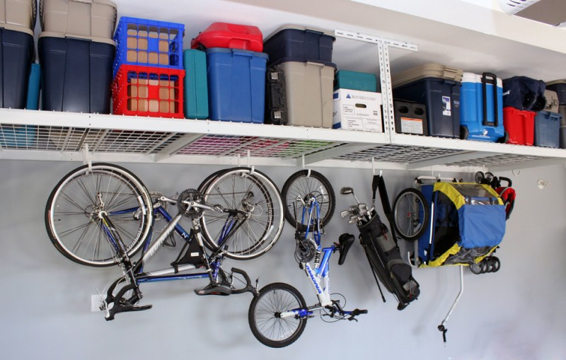 bike rack for apartment overhead rack utility boxes shed wheels bikes bicycles light colored wall metal