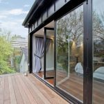 black framed glass bifold door