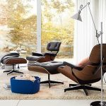 Black Leather Lounge Chair With Wooden Coat On The Back Of The Chair