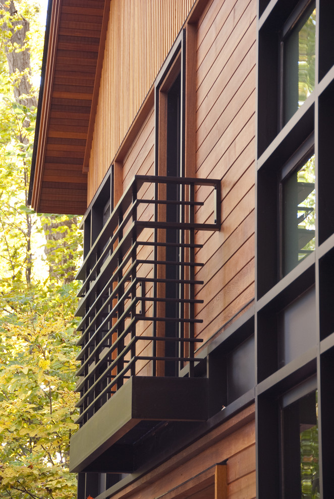 black metal balcony railing idea in modern minimalist style wooden siding exterior idea