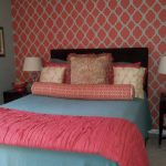 Blue Bed Sheet With Coral Schemed Blanket Various Colors & Textures Pillow Shams Black Headboard Coral White Wallpaper Wooden Bedside Tables Blue Wall System