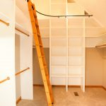 Bottom To Ceiling White Melamine Walk In Closet Idea With Movable Wooden Ladder With Railing System Support