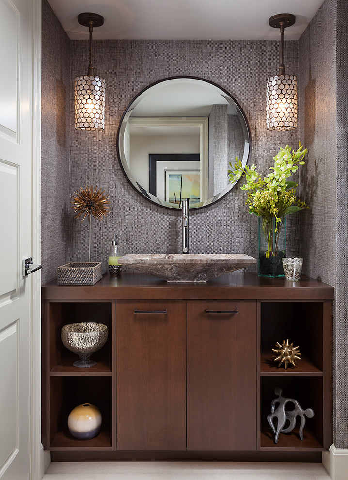 brown marble square sink, silver faucet, brown wooden cabinet, round mirror