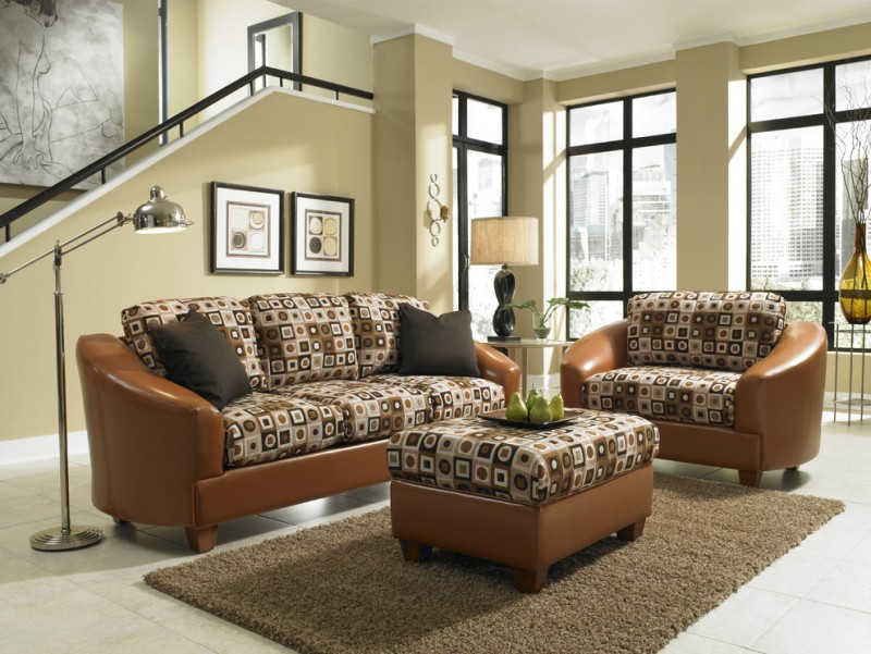 brown sofa with brown pattern cushion and matching ottoman for coffee table