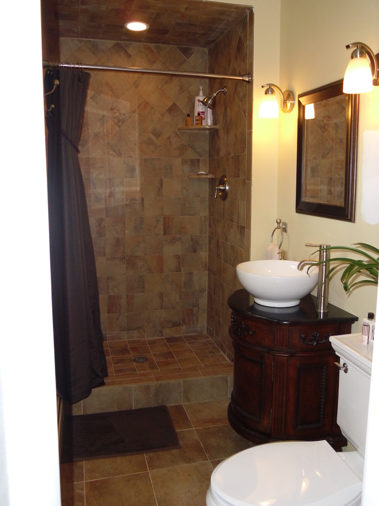 brown traditional small master bathroom with shower area, white toilet, white sink, brown cabinet
