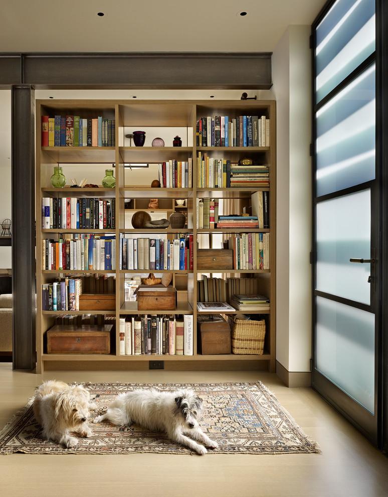 brown wooden bookshelves divider