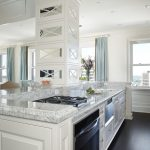 cashmere countertops kitchen dark floor cabinet curtains windows transitional kitchen stove chairs ceiling lamps