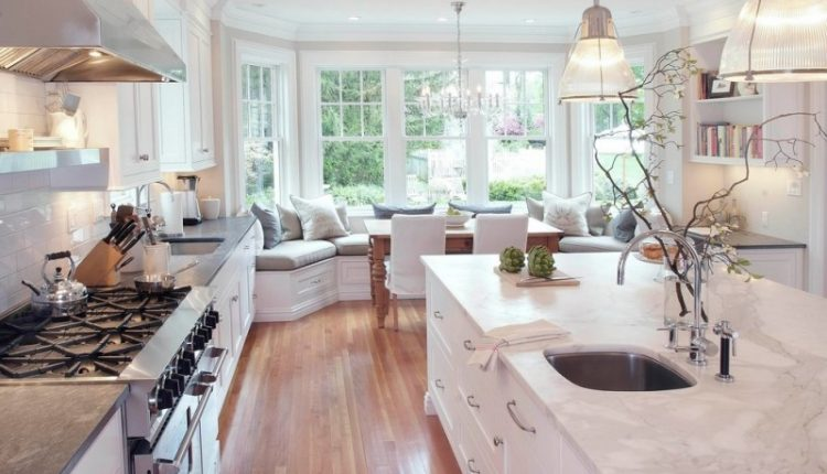 cashmere countertops kitchen faucet sink wood floor stove shelf bench pillows cabinet big windows dining chairs table lamps