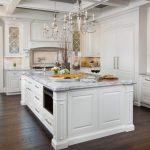 cashmere countertops kitchen wood floor white cabinets drawers chandelier door ceiling lamp appliances