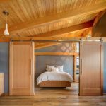 Clean Rustic Bedroom Idea Cedar Bed Without Headboard White Duvet Pillows With Modern Motif Covers Sliding Barn Door Simple White Pendant Lamps Oak Floors
