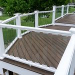 Clear Glass Railings With White Wooden Frames Large Deck With Wooden Siding Floors