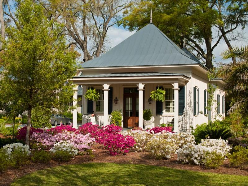 compact house design flower garden pillars windows chairs door traditional look wall lamps car exterior
