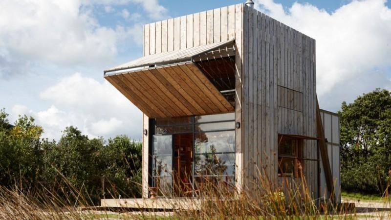 compact house design window door glass wood exterior unique design simple look wooden parts