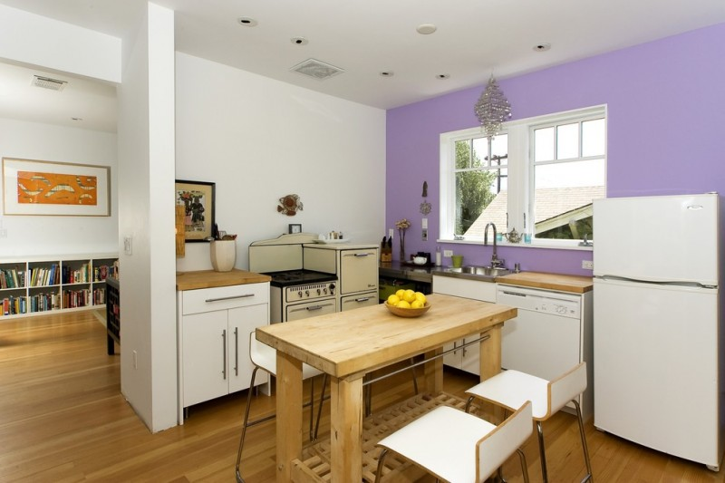 contemporary L shape kitchen design with purple and white walls white flat panel cabinets wood countertop wood white appliances wood dining table modern white stools