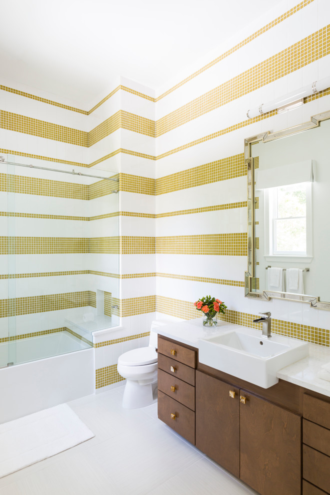 contemporary bathroom idea white yellow tiles walls white toilet white top bathroom vanity darker wooden cabinets